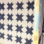 American quilts exhibition - picture of an Indigo Feathered Star quilt
