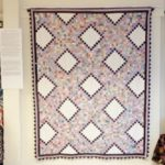 American quilts exhibition - picture of a feedsack postage stamp quilt