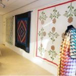 American quilts exhibition - picture of a pre-Civil war appliqued quilt and a quilted coat